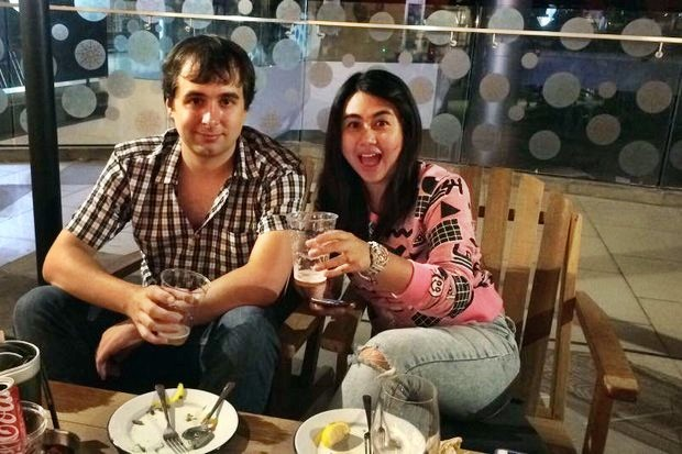 The late internet darkweb webmaster Alexandre Cazes and his wife Sunisa Thapsuwan enjoy a beer at a pub earlier this year. Thai investigators are focussing on Ms Sunisa, known to own three bank accounts, a Bitcoin account and a Mini Cooper, as well as joint ownership of property and currency accounts worth several hundred million baht. (Facebook photo)