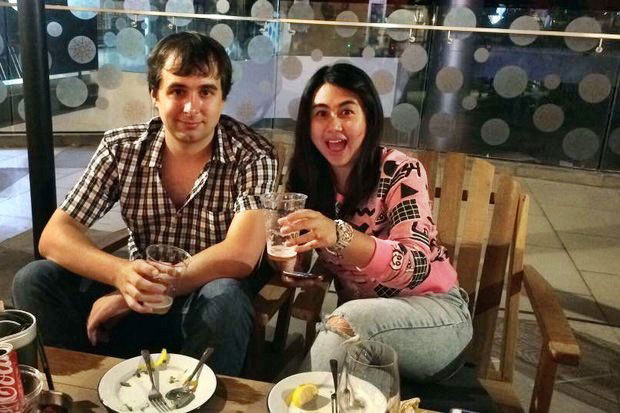 The late internet darkweb webmaster Alexandre Cazes and his wife Sunisa Thepsuwan enjoy a beer at a pub earlier this year. (Facebook photo)