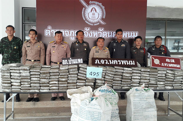 A haul of 495kg of compressed marijuana seized from four Lao drug couriers is displayed by police at a media briefing in Nakhon Phanom.