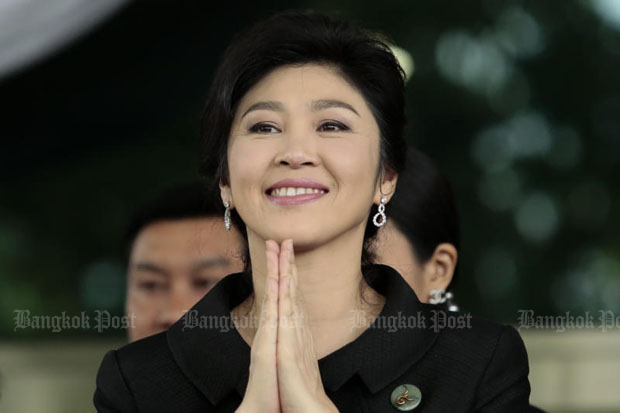 Former prime minister Yingluck Shinawatra reacts to supporters at the Supreme Court's Criminal Division for politician in Bangkok after the last witness hearing on her rice scheme case on July 21. (Photo by Patipat Janthong)