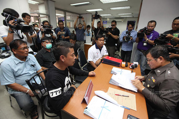 Van drivers report to Thung Song Hong police station on Monday, after taking supporters of former prime minister Yingluck Shinawatra to the Supreme Court last Tuesday. (Photo by Thiti Wannamontha)