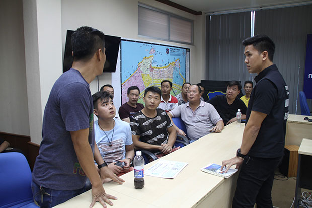 Chinese nationals are charged with illegally working at Pattaya police station on Tuesday. (Photo by Chaiyot Pupipattanapong)