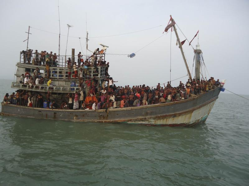 Suspected human trafficking victims are crammed on a Thai trawler, which was rescued by the Bangladesh Coast Guard, in southern Bangladesh on June 11, 2014, in this handout picture provided by the Bangladesh Coast Guard.