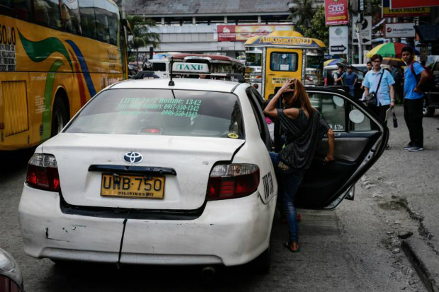 A woman boards a taxi in Manila, Philippines, 15 Aug 2017. (EPA photo)