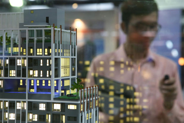 New condo projects are displayed at a housing fair.TANAPHON ONGARTTRAKUL