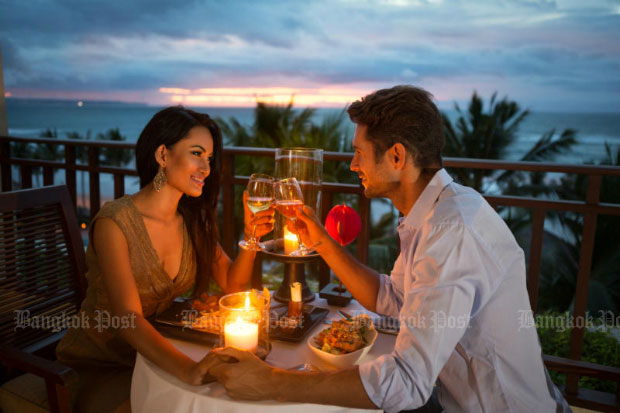 A young couple enjoy a romantic dinner by candlelight in June 2017.  (Bangkok Post photo)