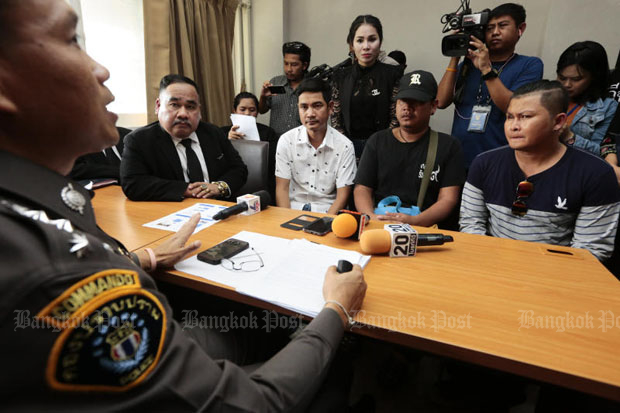 Lawyer Songkran Achariyasap (seated left) and some of the victims file their complaints at the Crime Suppression Division in Bangkok on Tuesday. (Photo by Patipat Janthong)