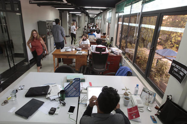 The Cambodia Daily's editorial staff work in their office in Phnom Penh on Sunday. (AP photo)