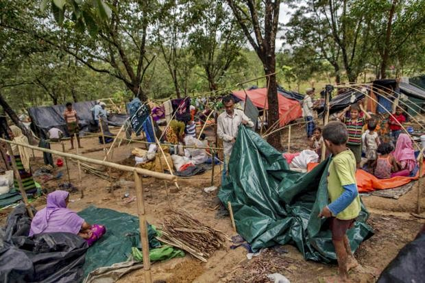 A group of Rohingya families tear down their makeshift shelters to prepare to move to a registered refugee camp in Bangladesh on Sunday. (AP photo)