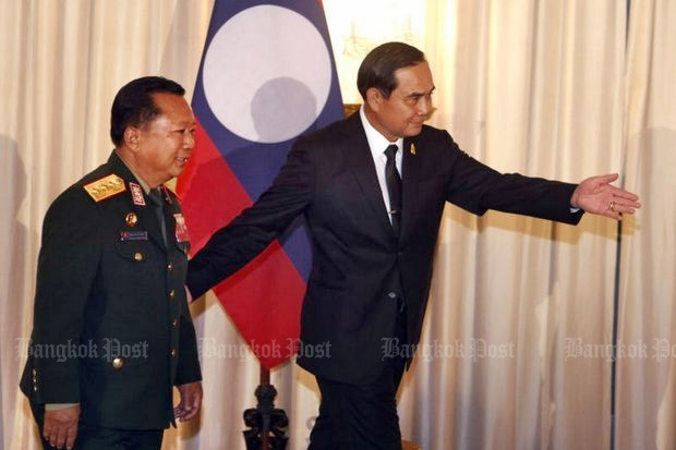 Lao Defence Minister Lt Gen Chansamone Chayalath pays a courtesy call on Thai Prime Minister Prayut Chan-o-cha at Government House in January. Thailand no longer perceives Laos as its closest and best friend. (Photo by Thanarak Khunton)