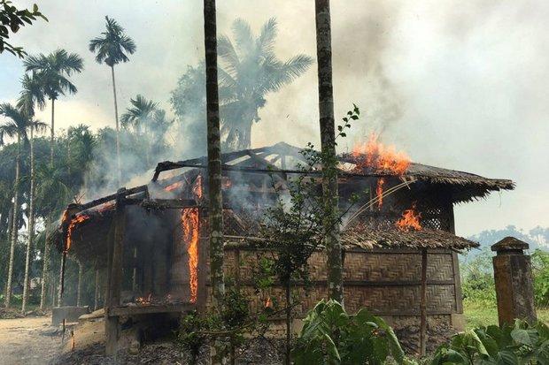 Photo taken Sept 7 shows flames engulfing a home in Gawdu Zara village, northern Rakhine state. (AP photos)