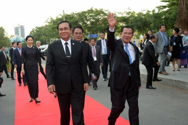Prime Minister Prayut Chan-o-cha walks with Cambodian counterpart Hun Sen during a visit to Phnom Penh. Cambodia is Southeast Asia's most authoritarian country but followed closely by its neighbour. (Photo courtesy Government House)