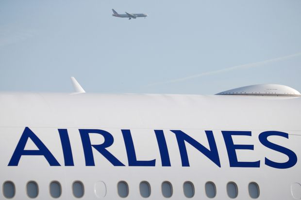 An aircraft flies over a Boeing 777-300ER aeroplane of China Airlines during the 51st Paris Air Show at Le Bourget airport near Paris on June 16, 2015. (Reuters file photo)