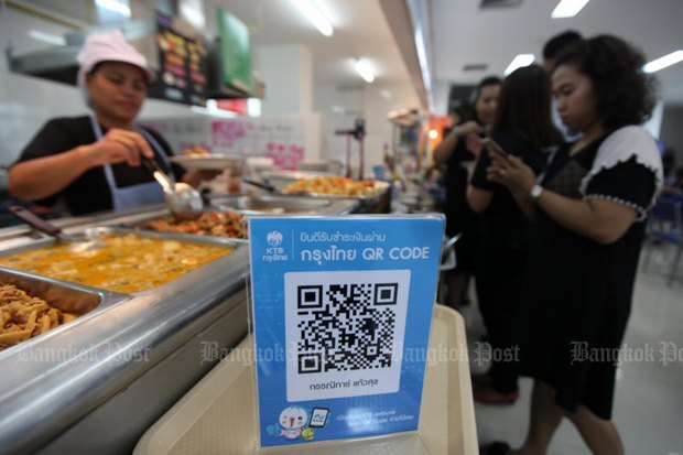 Authorities are experimenting with QR codes as a possible aid to a secure e-payment system, such as this Krungthai Bank setup at a Bangkok food court. (Photo by Thiti Wannamontha)