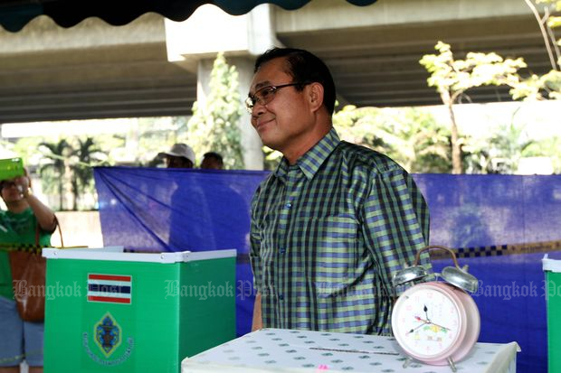 Then army chief Gen Prayut Chan-o-cha casts a ballot in the Feb 2, 2014 general election in Bangkok. The poll was later nullified following a Constitutional Court ruling. (Bangkok Post file photo)