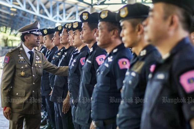 New Tourism Police Bureau acting deputy Pol Maj Surachet Hakpan (in khaki uniform) vows strong action against foreign 'mafia' figures in Phuket by his Special Operation Division forces, seen here during a formal inspection. (Bangkok Post file photo by Supakit Buyam)
