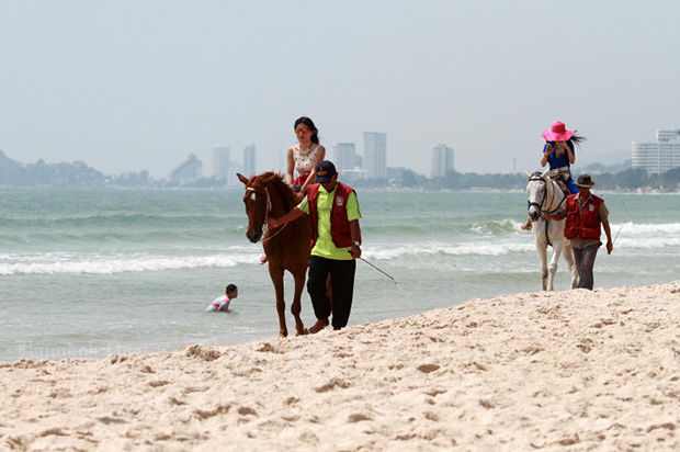 Horse riding on Hua Hin beach, a popular activity for domestic and international tourists. (Bangkok Post file photo)