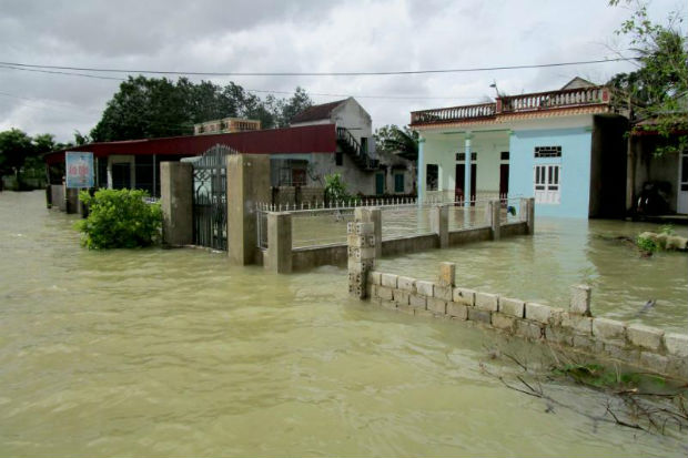 Floods surround houses in Thanh Hoa, Vietnam, on Tuesday. (EPA photo)
