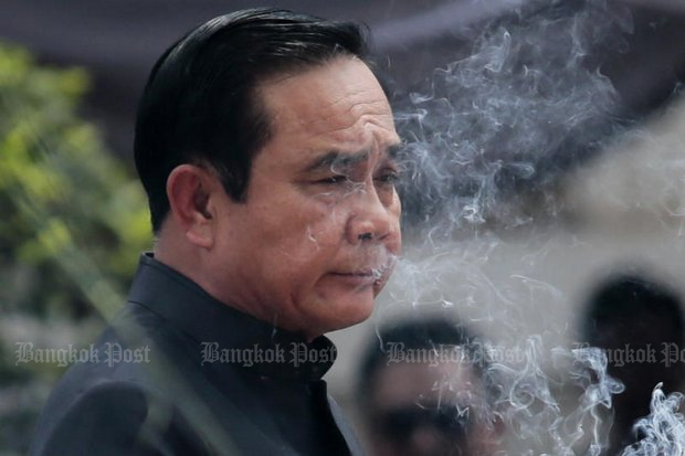 Prime Minister Prayut Chan-o-cha presides over a ceremonial rite last month to prepare for the royal cremation of the late King Bhumibol Adulyadej. (Photo by Patipat Janthong)
