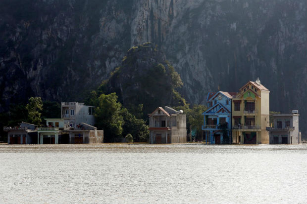 Submerged houses are seen at a flooded village after a heavy rainfall caused by a tropical depression in Ninh Binh province, Vietnam, on Saturday. (Reuters photo)
