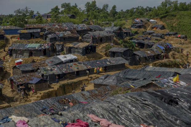 In this Sept 26, 2017 file photo, newly set up tents cover a hillock at a refugee camp for Rohingya Muslims who crossed over from Myanmar into Bangladesh, in Balukhali refugee camp, Bangladesh. (AP Photo)