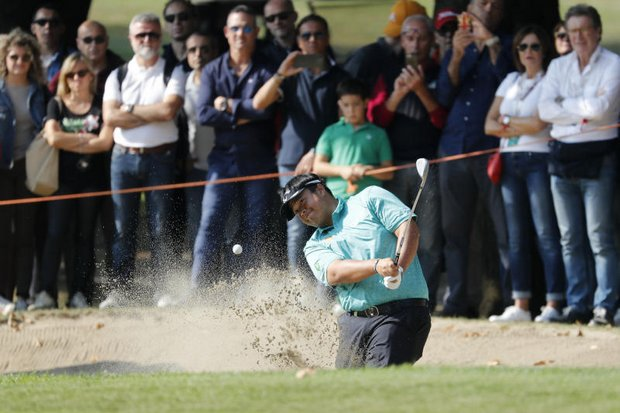 Kiradech Aphibarnrat blasts out of sand onto the green during the tournament's final round on Sunday. (AP photo)