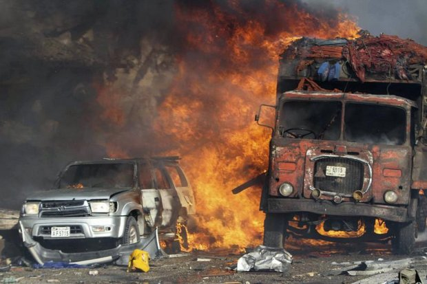 Vehicles burn at the scene of a massive truck bomb explosion in front of the Safari Hotel in the Somalian capital Mogadishu. (EPA photo) (NOTE: To see this photo in full colour, press the