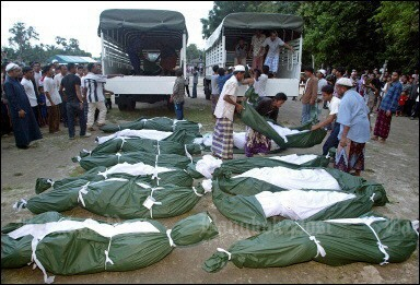 October, 2004: The bodies of young men crushed and smothered to death are removed from army trucks. (File photo)