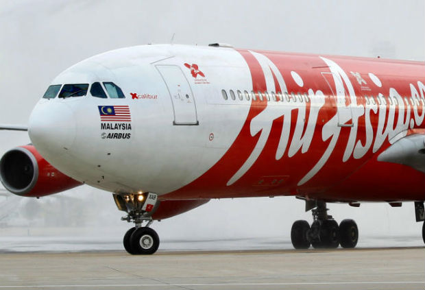 An AirAsia X Airbus A340 passenger jet arrives on its inaugural flight from Kuala Lumpur to Paris Orly Airport February 14, 2011. (Reuters file photo)