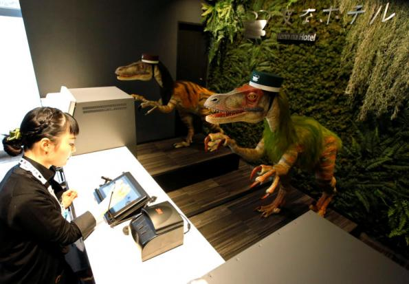 Dinosaur robots acting as receptionist greet a hotel employee demonstrating how to check-in to the hotel during a press preview for the newly-opening Henn na Hotel Maihama Tokyo Bay in Urayasu, east of Tokyo, on March 15, 2017. (Reuters photo)