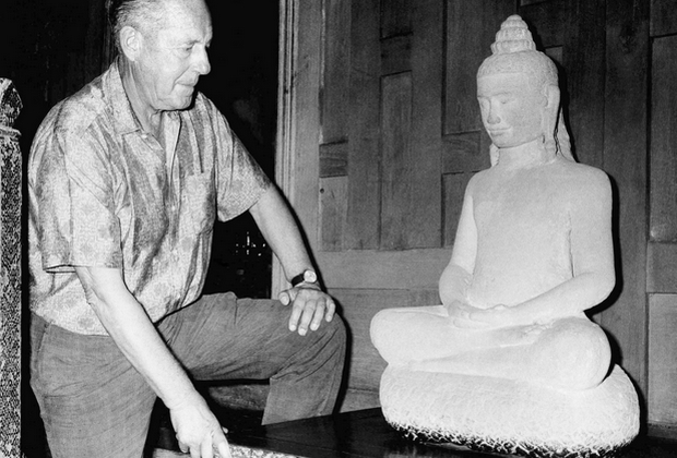 In this picture taken in 1966, American businessman Jim Thompson admires a Buddha statue in Bangkok. A new documentary is expected to stir fresh debate over the mystery of Thompson's death. (AP File Photo)