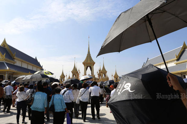 Visitors walk towards the royal crematorium at Sanam Luang in Bangkok on Thursday, when it was first opened to the public. (Photo by Pattarapong Chatpattarasill)