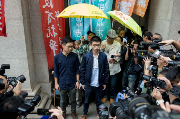 Demosisto leader Joshua Wong (centre-right) and disqualified lawmaker Nathan Law (centre-left) speak to reporters outside of the Court of Final Appeal in Hong Kong, China, on Tuesday. (EPA photo)