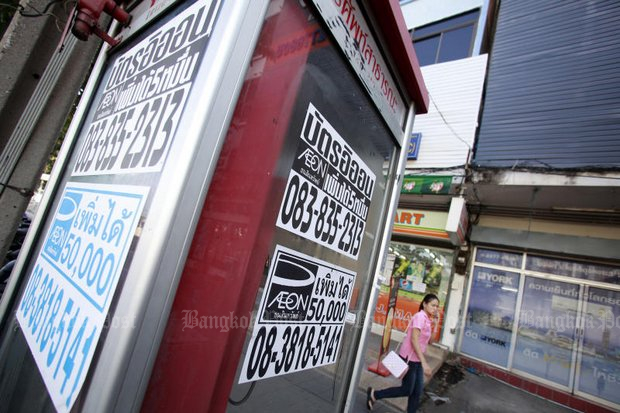 One of Bangkok's most familiar street sights is the enticing poster promising easy loans, fast. They come with massive interest. (Bangkok Post file photo)