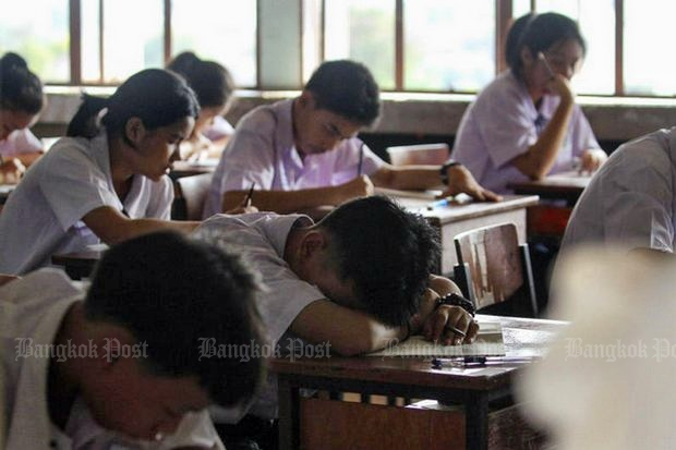 Mathayom 3 students sit the Ordinary National Education Test exam at a school in Bangkok. (File photo by Pattarapong Chatpattarasill)