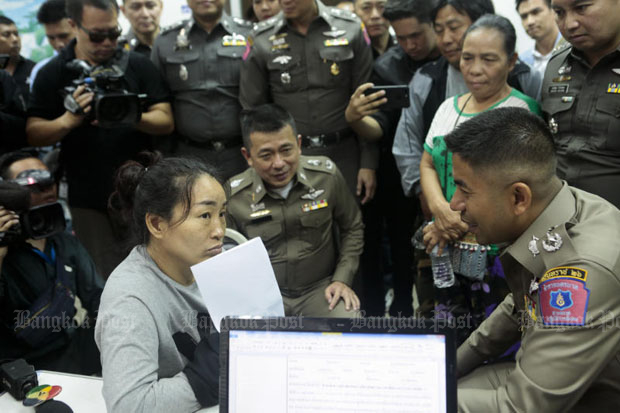 A Chinese woman (left), whose real name was not revealed, is questioned by Pol Maj Gen Surachet Hakpal (right), acting deputy commissioner of tourist police at the Chokechai police station in Bangkok on Wednesday. Nakham Manae (right), a Lahu tribeswoman whose identity was stolen, looks on. (Photo by Patipat Janthong)