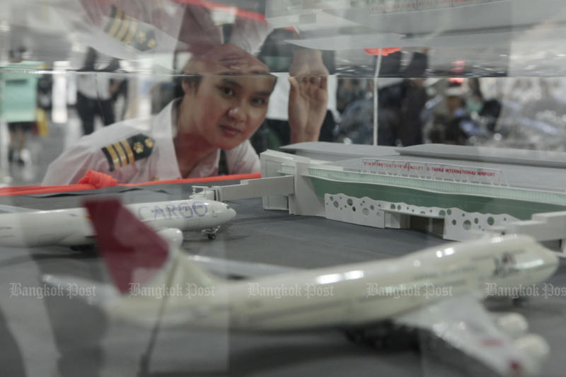 An official looks at the model showing the expansion of U-tapao airport as part of the Eastern Economic Corridor scheme. (Photo by Pornprom Satrabhaya)