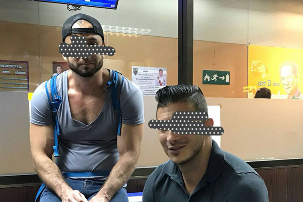 A photo released by the Immigration Bureau shows two American men arrested at Don Mueang airport, Bangkok, Tuesday night. On Wednesday Bangkok police prepared more severe charges in relation to their posted bare-butts photos taken at the well-known Temple of Dawn.