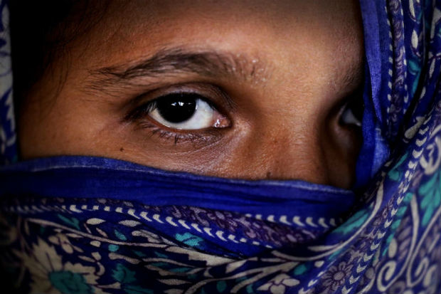 M, 35, mother of three, who says she was raped by members of Myanmar's armed forces in late August, is photographed in her friend's tent in Kutupalong refugee camp in Bangladesh, Nov 20, 2017. (AP photo)