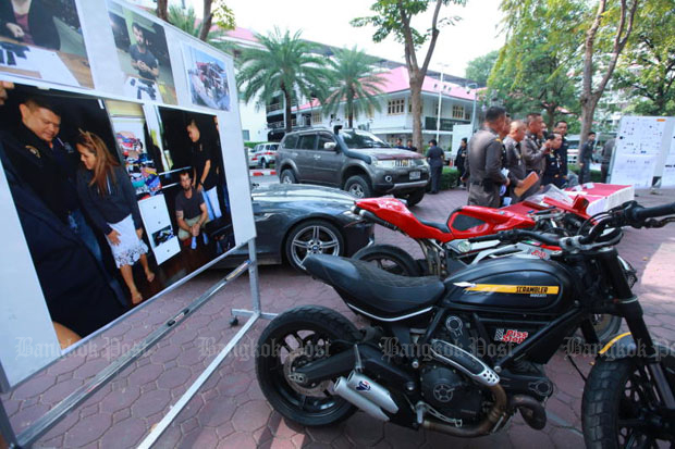 Some of the assets seized from Hells Angels gang member Luke Cook and his Thai wife displayed at the Royal Thai Police Office in Bangkok during a news briefing on Tuesday. (Photo by Somchai Poomlard)