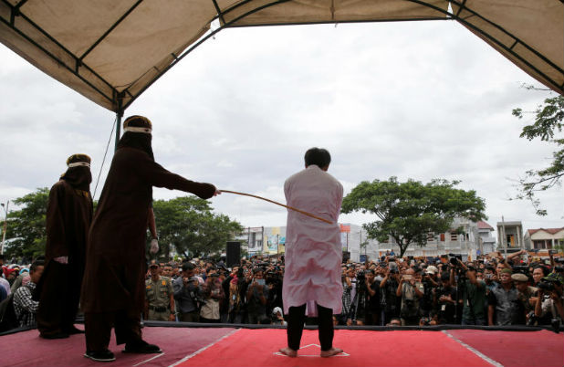 An Indonesian man is publicly caned for having gay sex in Banda Aceh, Aceh province, Indonesia May 23, 2017. (Reuters file photo)