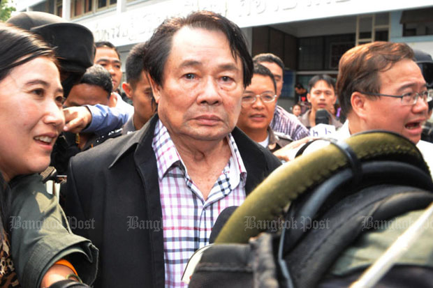 Somchai Khunploem, alias Kamnan Poh, is taken to the Crime Suppression Division following his arrest at a Lat Krabang toll gate in February 2013. (Photo by Pattanapong Hirunard)