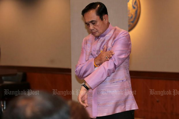 Asked the time by the media on Tuesday, Prime Minister Prayut Chan-o-cha showed off what he said was his everyday watch, a 250,000-baht Seiko, which he declared to the National Anti-Corruption Commission upon taking office in September of 2014. (Photo by Chanat Katanyu)