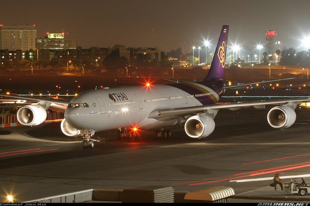 A Thai Airways International Airbus A340 taxis at Jinnah International Airport. A Malaysian backer of Islamic State carrying firearms and ammunition was detected by security before he could board a THAI flight to Bangkok. (File photo via historyofPIA.com)