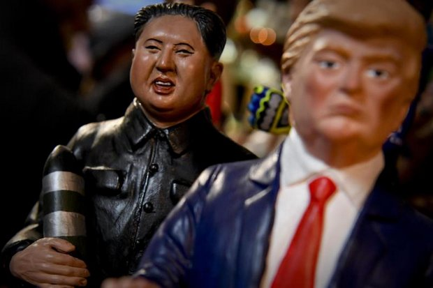 Small terracotta figurines depicting US President Donald Trump (right) and North Korean Leader Kim Jong-un are on display in a workshop in Italy. (EPA photo)