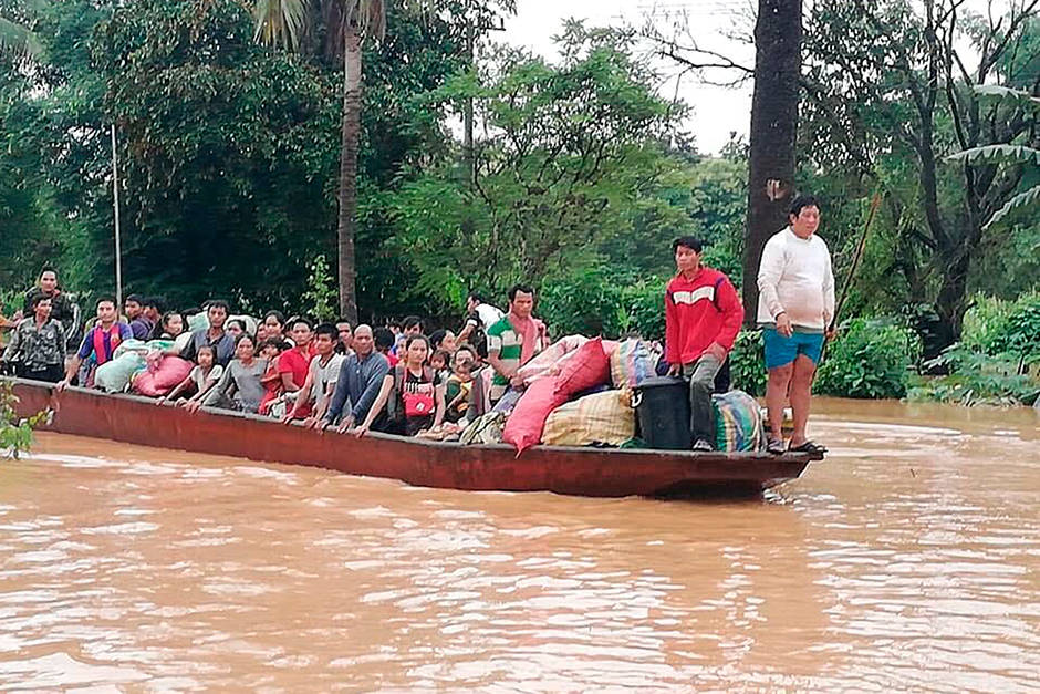People on a boat are evacuated in the floodwaters from the collapsed Xe Pien-Xe Nammoy dam in Sanamxay district, Attapeu province, on Tuesday. — Attapeu TV/ AP
