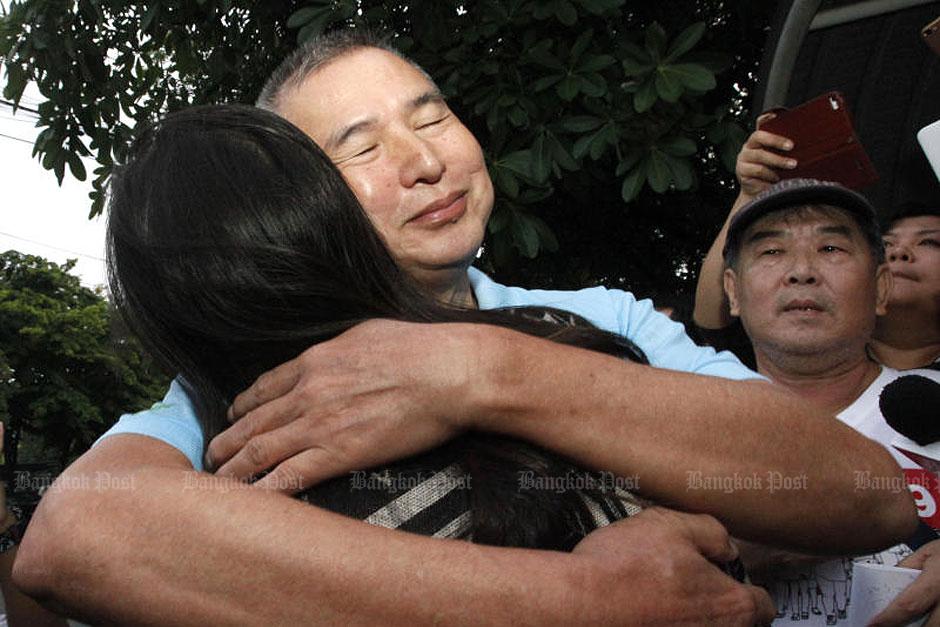 Somyot Prueksakasemsuk hugs his daughter, Prakaidao, after being released from Bangkok Remand Prison. Pornprom Satrabhaya