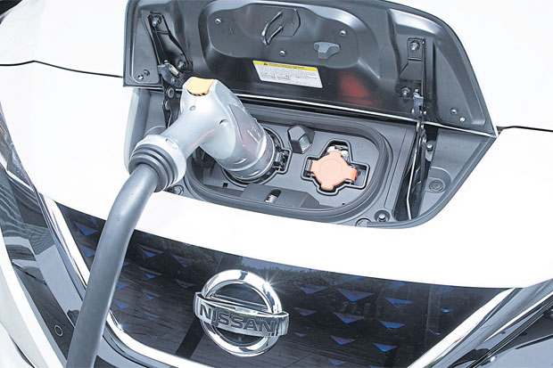 A Nissan Leaf electric car is being charged.