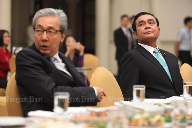 Deputy Prime Minister Somkid Jatusripitak with Prime Minister Prayut Chan-o-cha Monday. Mr Somkid had a tense visit to the Ministry of Science and Technology on Monday. (Photo by Thiti Wannamontha)