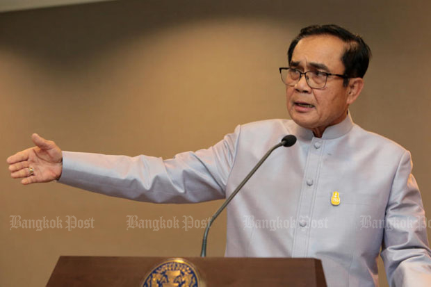 Prime Minister Prayut Chan-o-cha gestures during a press conference at Government House. His Section 44 orders will be passed into law through the National Legislative Assembly. (File photo)